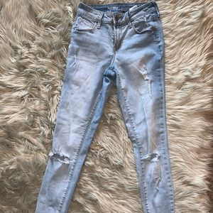Light blue wash ripped jeans